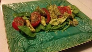 Caprese salad with spinach, avocado, tomato, and bouquet garnier